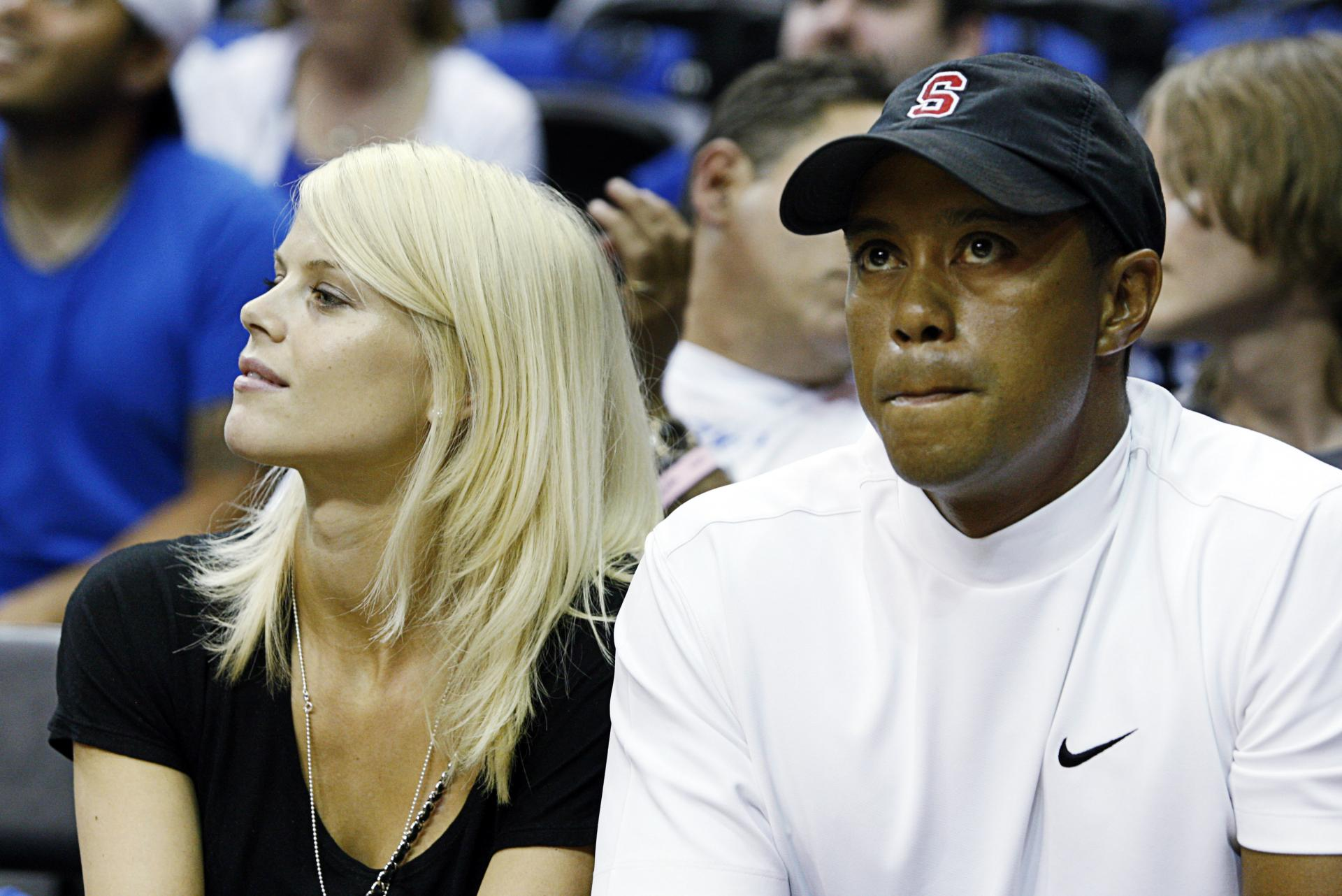 Tiger woods, girlfriend named in wrongful