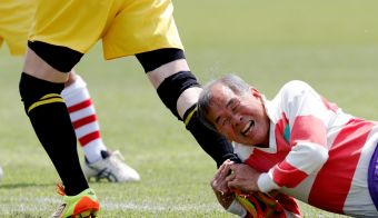 "A player of Fuwaku Rugby Club play tackles against another club team player during their match in Kumagaya, Saitama Prefecture, Japan, May 3, 2019. Fuwaku, founded in 1948, is one of approximately 150 Japanese clubs that stage competitive, full-contact matches for players over the age of 40. REUTERS/Kim Kyung-Hoon SEARCH ""RUGBY VETERANS"" FOR THIS STORY. SEARCH ""WIDER IMAGE"" FOR ALL STORIES. TPX IMAGES OF THE DAY FOTO: Kim Kyung-hoon Reuters"